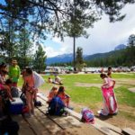 Hodia camp activity with kids and adult supervision.