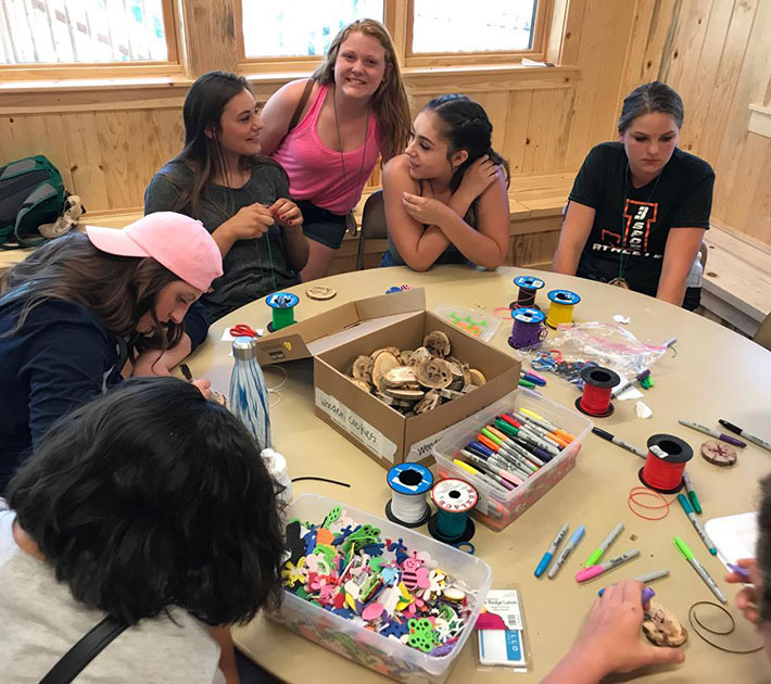 Girls with craft supplies.