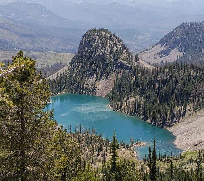 Small lake at the base of a valley.