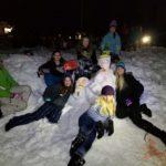 Kids in snow having fun.