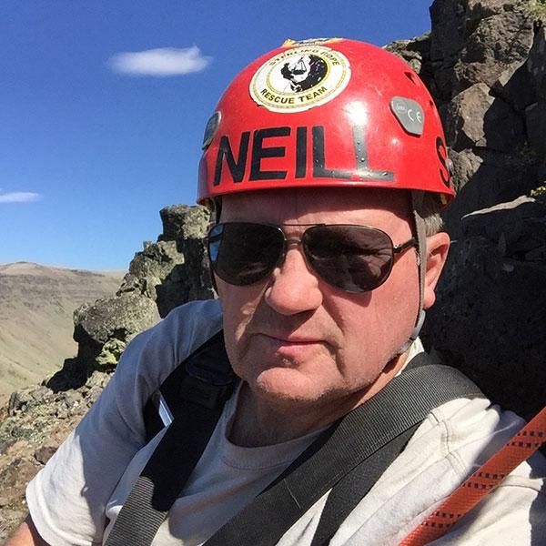 Neill Goodfellow with rock climbing gear