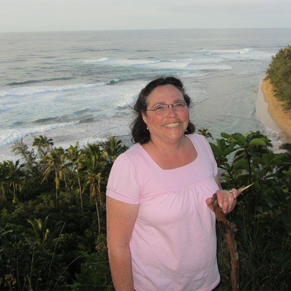 Irene Torgesen posing in front of ocean